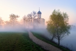 Church of Intercession of Holy Virgin on Nerl River in spring at sunrise, spring sunrise in Bogolyubovo, Russia