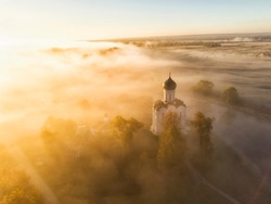 Church of Intercession upon Nerl River. (Bogolubovo, Vladimir region, Golden Ring of Russia) in autumn morning. Aerial photo