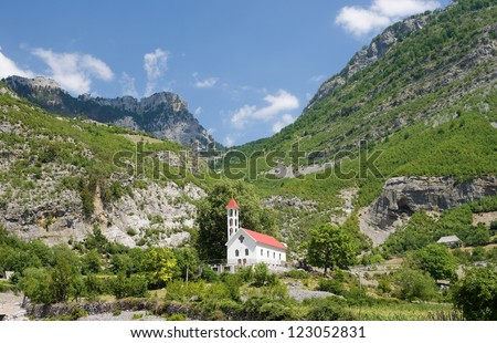 Church of Nikc in the Commune of Kelmend on background the mountains of North Albania
