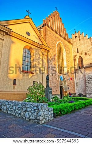 Church of Saint Francis Assisi in the Old town in Krakow, Poland. People on the background #557544595