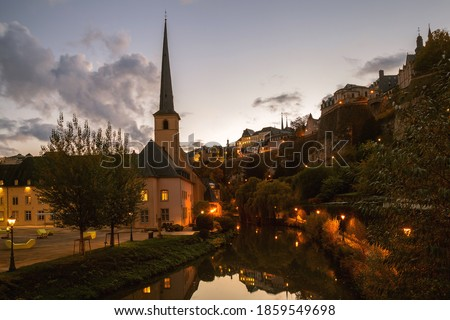 Church of Saint John in Grund, Neimenster, Luxembourg historical centre at sunset with reflection in the water Stock photo ©