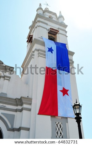 Church of San Atanasio tower covered with a huge Panamanian flag celebrating independence from Spain