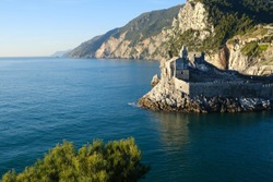 Church of San Pietro in Portovenere near the Cinque Terre. Sea and rocks overhanging the Ligurian sea in Italy.