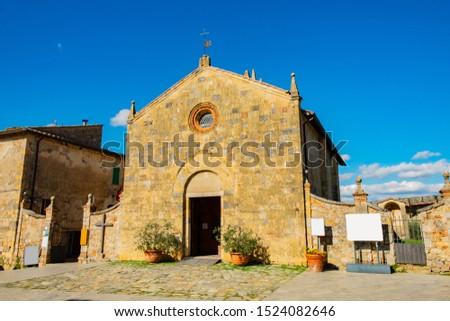 Church of Santa Maria Assunta (XIII century) in the ancient medieval village of Monteriggioni, Siena, Tuscany, Italy, Europe #1524082646