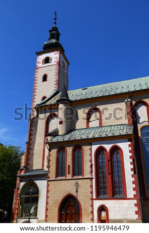 Church of the Assumption of  Blessed Virgin Mary in Banska Bystrica. Exterior against the blue sky. Slovakia. Tourist attraction, tourist destination #1195946479