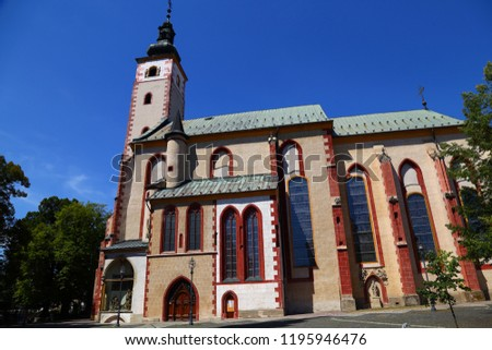 Church of the Assumption of the Blessed Virgin Mary in Banska Bystrica. Exterior against the blue sky. Slovakia. Tourist attraction, tourist destination #1195946476
