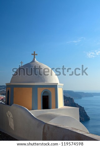 Church of the island of Santorini against the bright sky