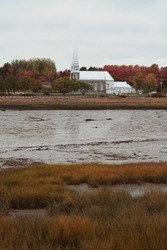 Church on Isle aux Coudres, St-Lawrence river, in autumn, Quebec, Canada