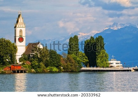 Church on Zurich Lake in Alps mountains
