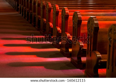 Church Pews in Reflected Stained Glass Lighting