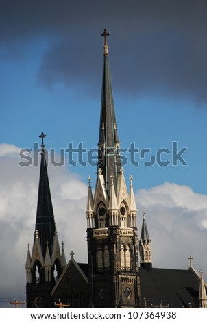 Church steeples stand out against an ominous sky