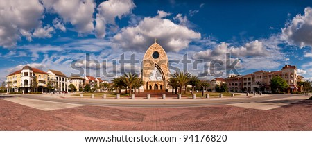 Church surrounded by modern buildings in Ave Maria, Florida - stock photo