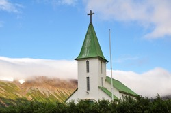 Church surrounded by mountains in Western Iceland