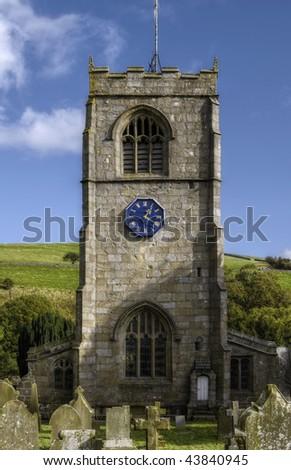 Church Tower against a blue sky in Burnsall, UK.
