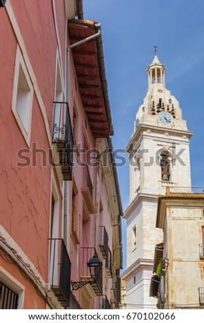 Church tower and red house in the center of Xativa, Spain #670102066