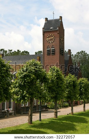 Church with a row of trees in Sloten(Holland)