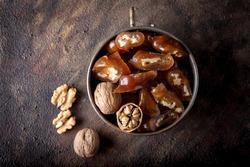 Churchkhela Pestil or Walnut Fruit Pulp in bowl on dark background.