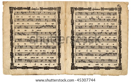 Churchly ritual page spread with musical notes symbols from the very old slavonic church manuscript book Cercovnyj Obihod isolated on white background