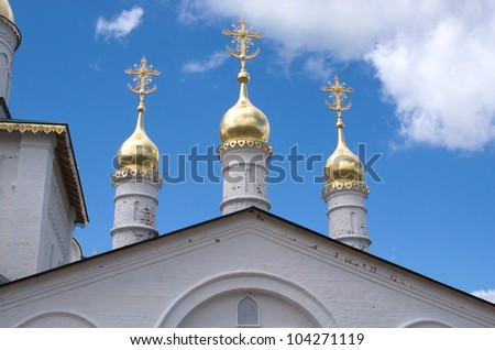 Churh cupolas over blue sky with clouds