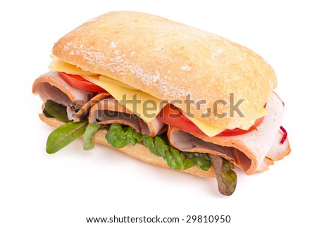Ciabatta bread sandwich stuffed meat,cheese and vegetables - stock photo