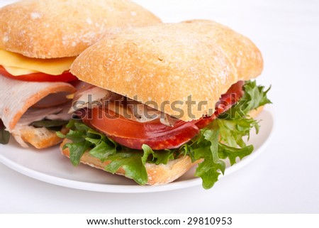 Ciabatta bread sandwiches stuffed meat,cheese and vegetables