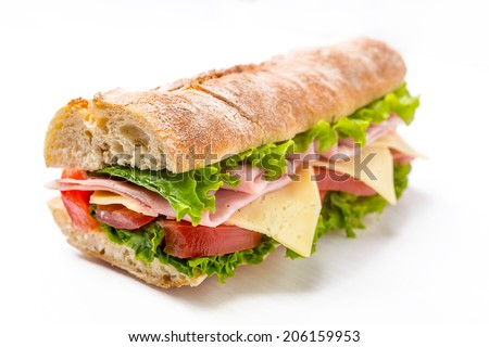 Ciabatta Sandwich with Lettuce, Tomatoes, Ham and Cheese cut in half