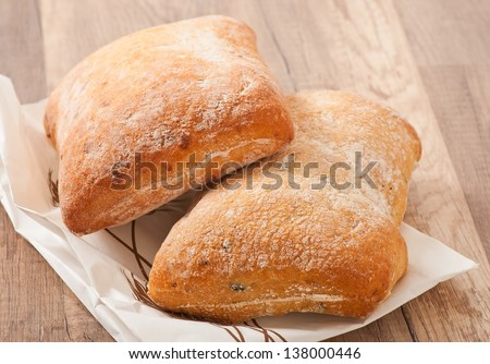 ciabatta with cheese on a wooden table
