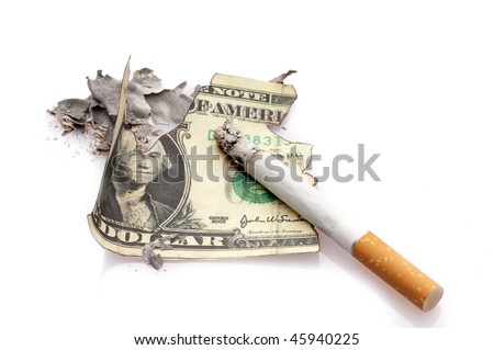 cigarette and burning dollar