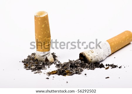 Cigarette butt and ash macro closeup, isolated