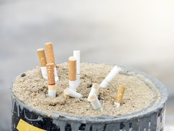 Cigarette butts and ashtrays