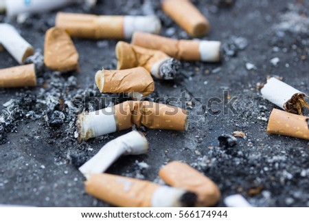 Cigarette butts. Smoking is bad for your health.