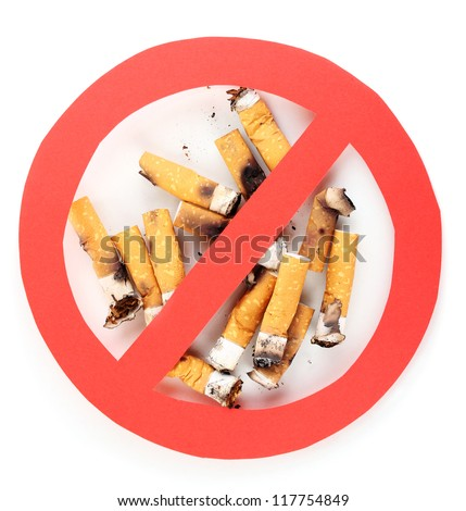 Cigarette butts with prohibition sign isolateed on white - stock photo