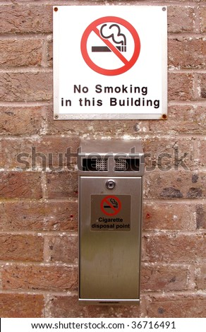 Cigarette disposal point with a no smoking sign - stock photo