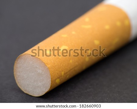 Cigarette filter macro on black textured background