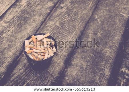 cigarette in outdoors ashtray...