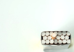 cigarette inside pagkage isolated on white background from top view.
