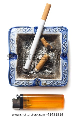 Cigarette, lighter and butts of cigarettes in the ashtrey