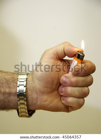 Cigarette lighter over white backdrop. This image has been converted from a RAW-format.