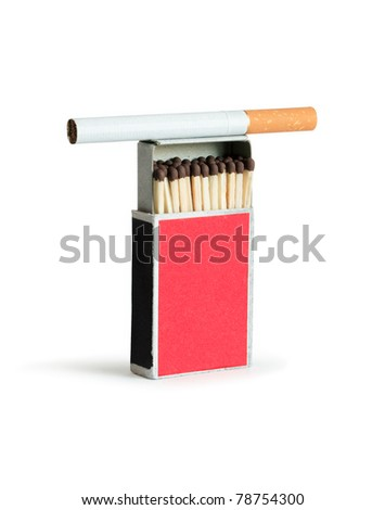 Cigarette lying on open matchbox. Isolated on white with clipping path