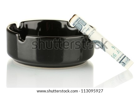 Cigarette of the 100 dollar bill and an ashtray isolated on white