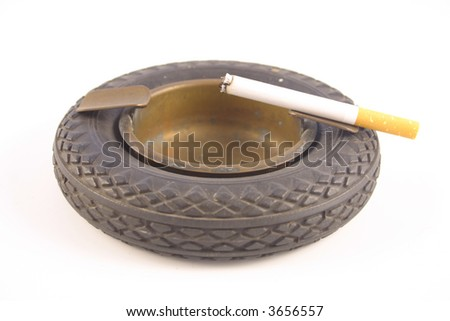 cigarette on old ash tray