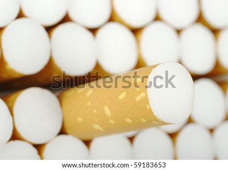 Cigarette pulled out of an open Cigarette packet (Selective Focus)