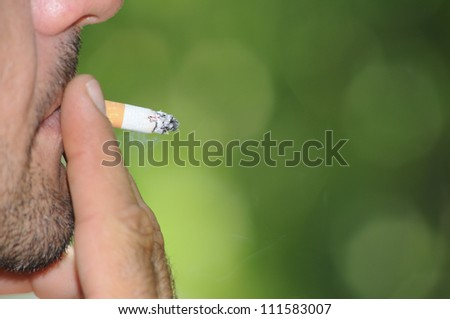 Cigarette smoking close up. - stock photo