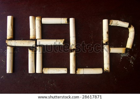 Cigarette stubs used to form the word help.
