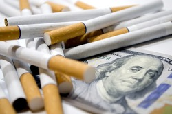 Cigarettes and dollar as aconcept of smoking costs