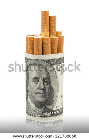 Cigarettes and money on a white background. - stock photo