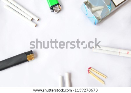 Cigarettes and objects on a white background, with #1139278673