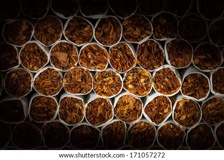 cigarettes background with spotlight, closeup view - stock photo