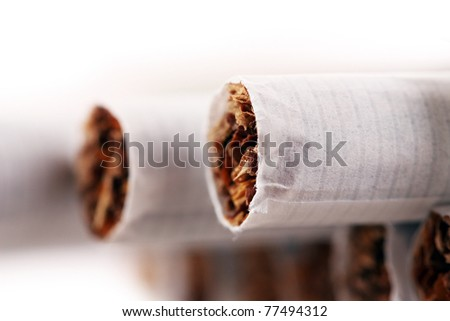 cigarettes closeup isolated on white