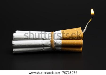 Cigarettes in dynamite concept on black